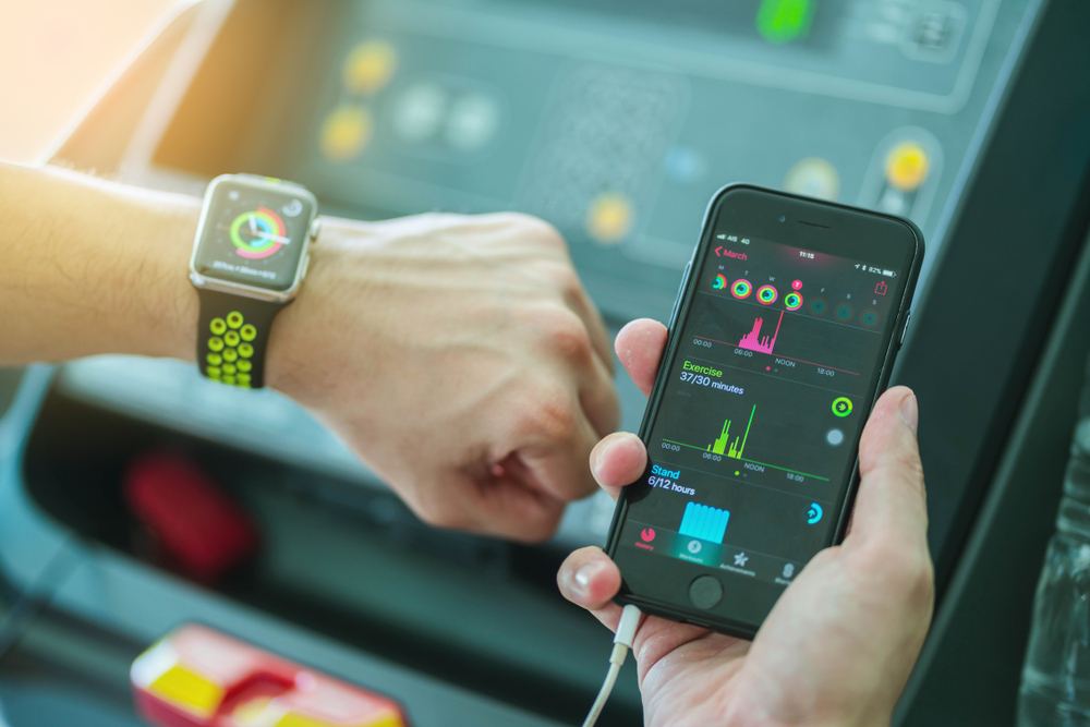 Person seeing Smart Watch and Mobile